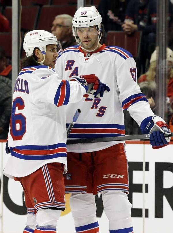 Rangers' Mats Zuccarello talks with teammate Benoit Pouliot