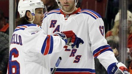 Rangers' Mats Zuccarello talks with teammate Benoit Pouliot