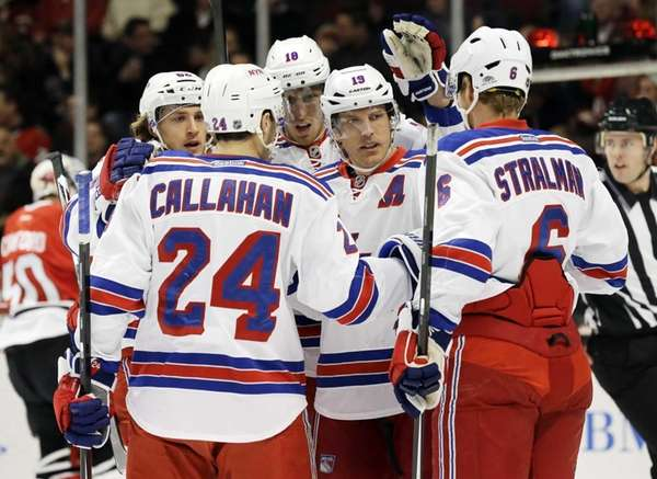 Rangers' Brad Richards celebrates with teammates after scoring