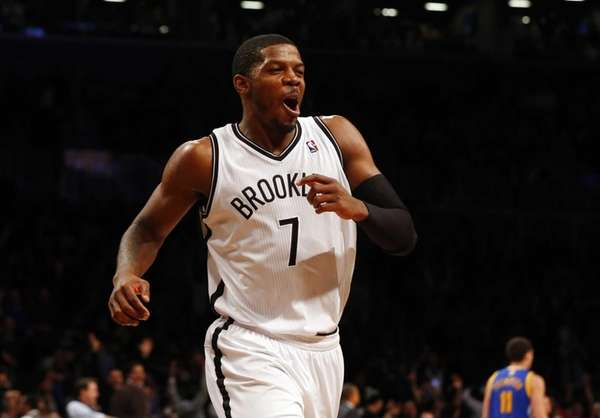 Joe Johnson of the Nets celebrates after a