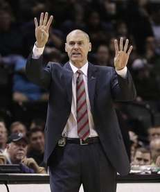 Dallas Mavericks coach Rick Carlisle calls to his