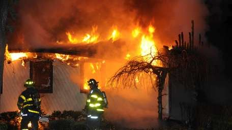 The Melville Fire Department responds to a house