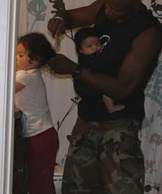 A picture of Doyin Richards brushing his daughter's