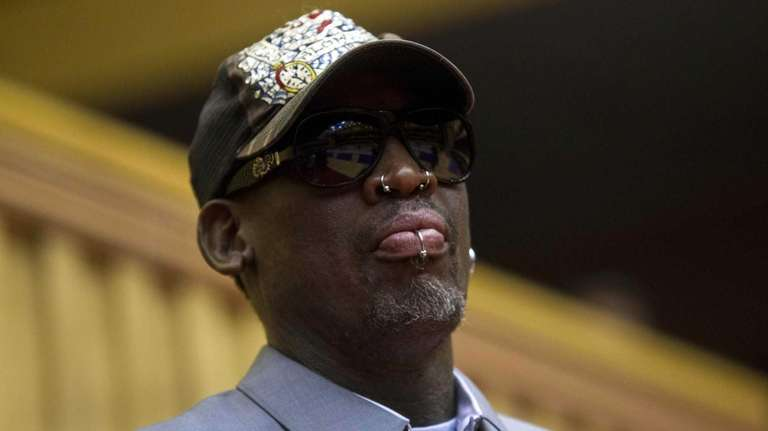 Dennis Rodman looks out at the court at