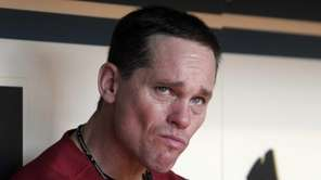Houston Astros' Craig Biggio watches a scoreboard tribute