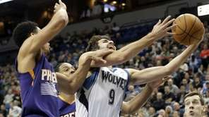 Minnesota Timberwolves' Ricky Rubio attempts a layup as