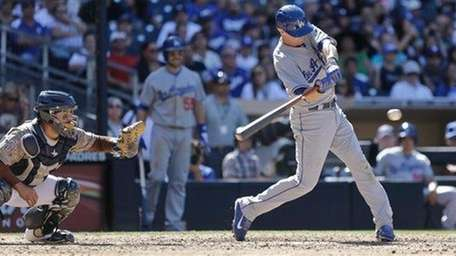 Michael Young slashes double to right field that