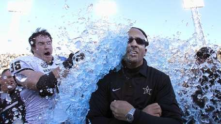 Vanderbilt coach James Franklin is doused by linebacker