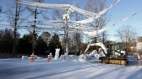 Ice covers power lines and the street after