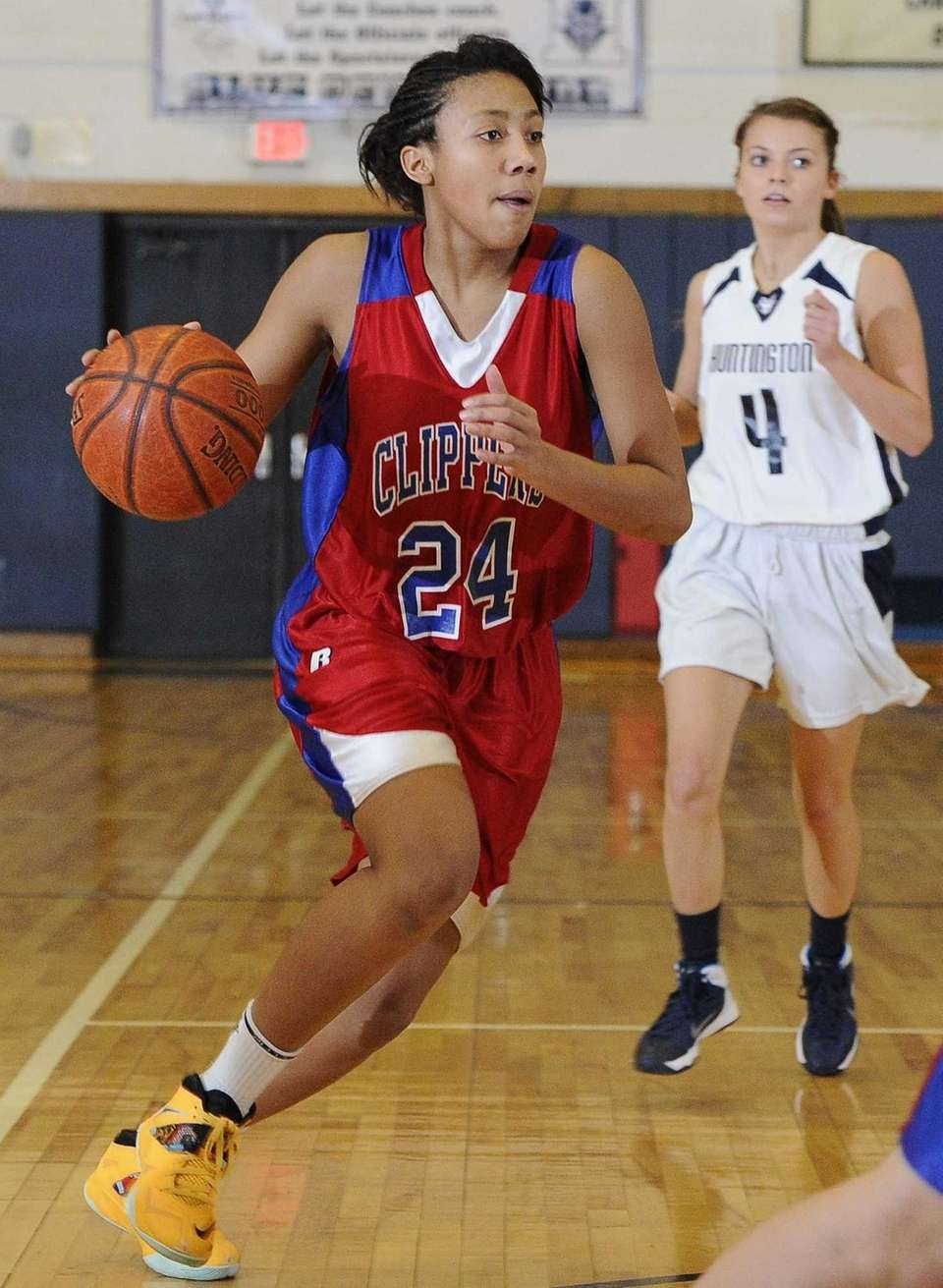 Bellport forward Arella Guirantes drives the ball against