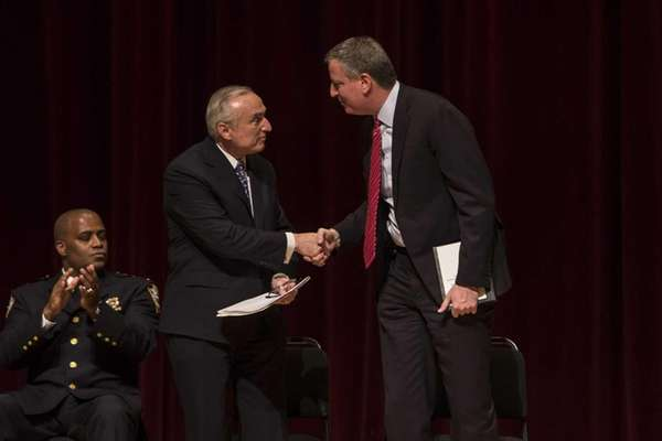 New York Police Police Commissioner William Bratton shakes