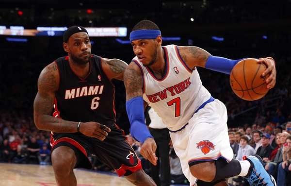 Carmelo Anthony of the Knicks drives against LeBron