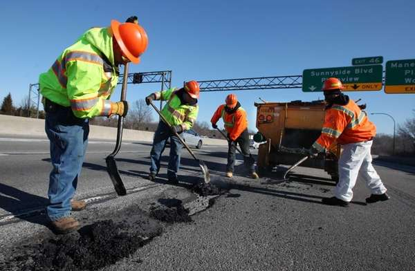 State Department of Transportation crews fill potholes on