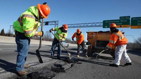 State Department of Transportation crews fill potholes on