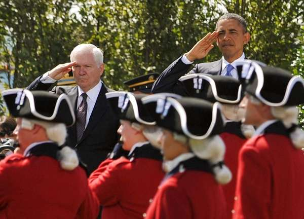 President Barack Obama and then-outgoing Defense Secretary Robert