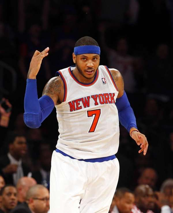 Carmelo Anthony of the Knicks reacts after hitting