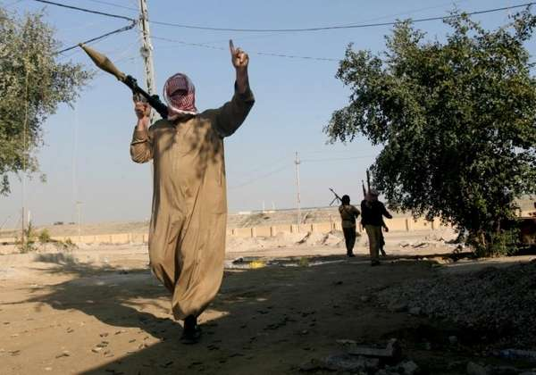 Gunmen patrol in Fallujah, 40 miles (65 kilometers)