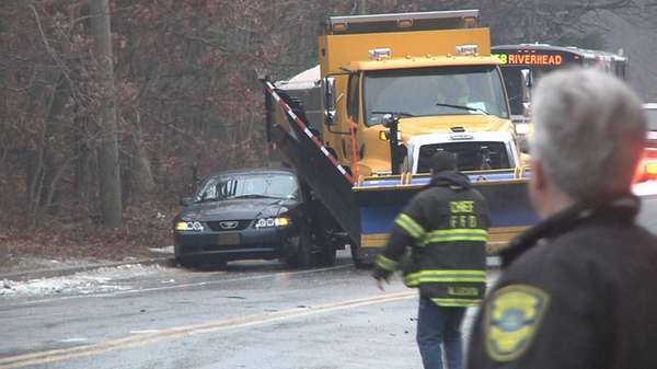 An accident involving a plow or sander truck