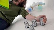 Appraiser Katherine Scheri runs water into a bathtub