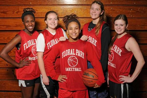 Floral Park sophomore Kaela Hilaire, center, poses for