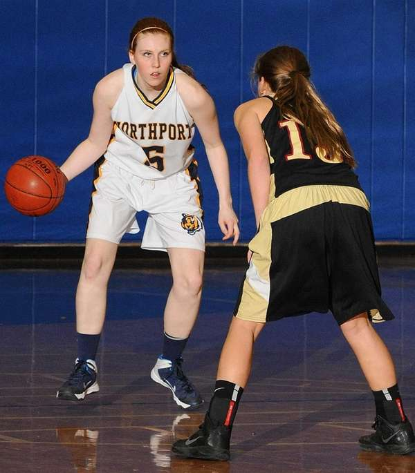 Northport's Lizzy Atkinson, left, looks to dribble past