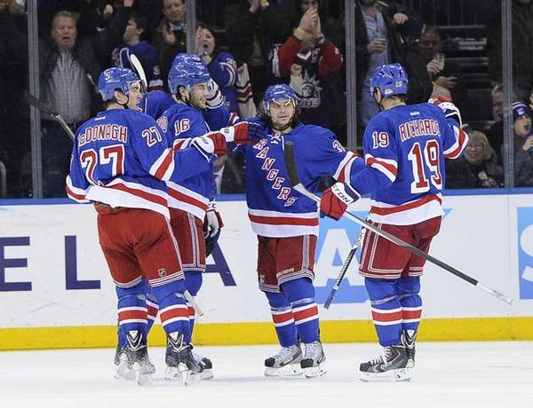 The Rangers celebrate a goal by center Derick