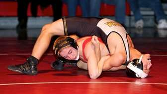 Connetquot's John Barrios flips Sachem North's John Sammertino