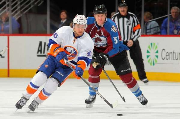 Michael Grabner of the Islanders controls the puck