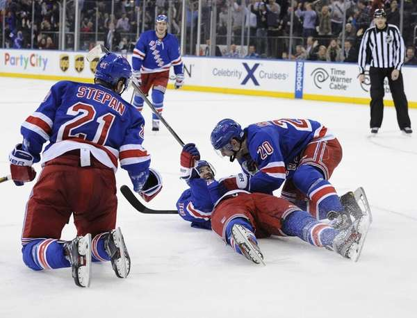 Rangers left wing Chris Kreider congratulates left wing
