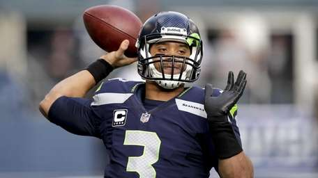 Russell Wilson warms up before his NFC divisional