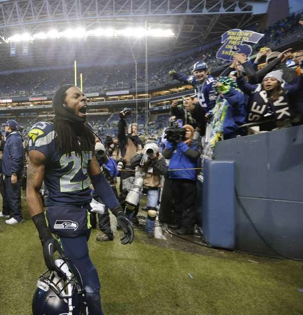 Richard Sherman celebrates after the Seahawks' 23-15 win