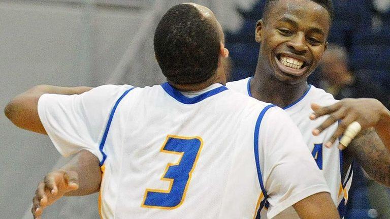 Stephen Nwaukoni, right, and Zeke Upshaw hug after