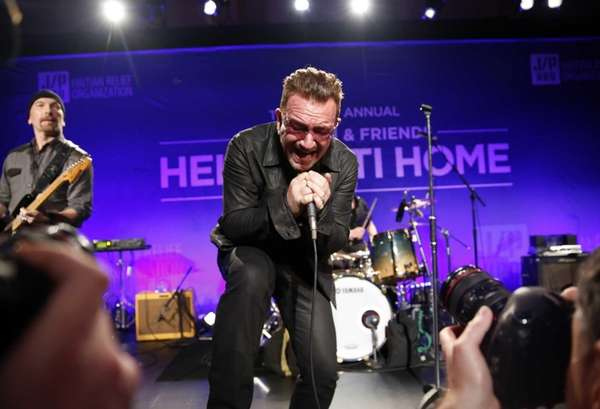 Bono performs at the third annual Sean Penn