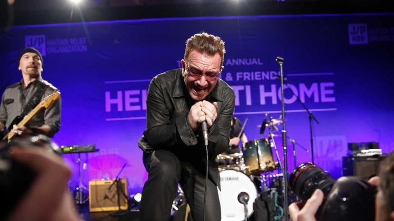 Bono performs at the third annual Sean Penn