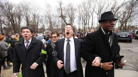 From left; Rabbi Todd Chizner, of Temple Judea