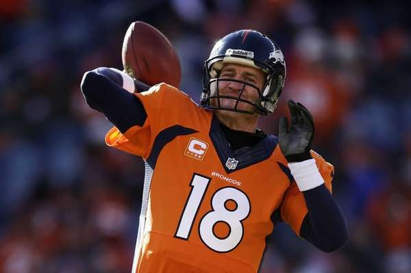Peyton Manning warms up before the AFC divisional