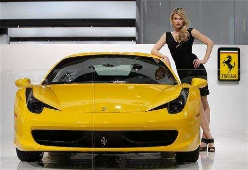 A model poses with the Ferrari 458 Italia
