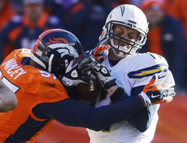 Philip Rivers is sacked by Broncos defensive end