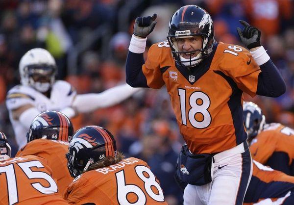 Denver Broncos quarterback Peyton Manning (18) calls an