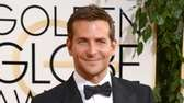 Nominee Bradley Cooper arrives at the 71st Golden