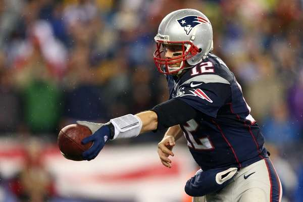New England Patriots quarterback Tom Brady hands off
