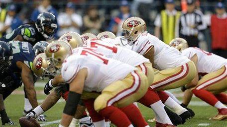 San Francisco 49ers quarterback Colin Kaepernick (7) stands