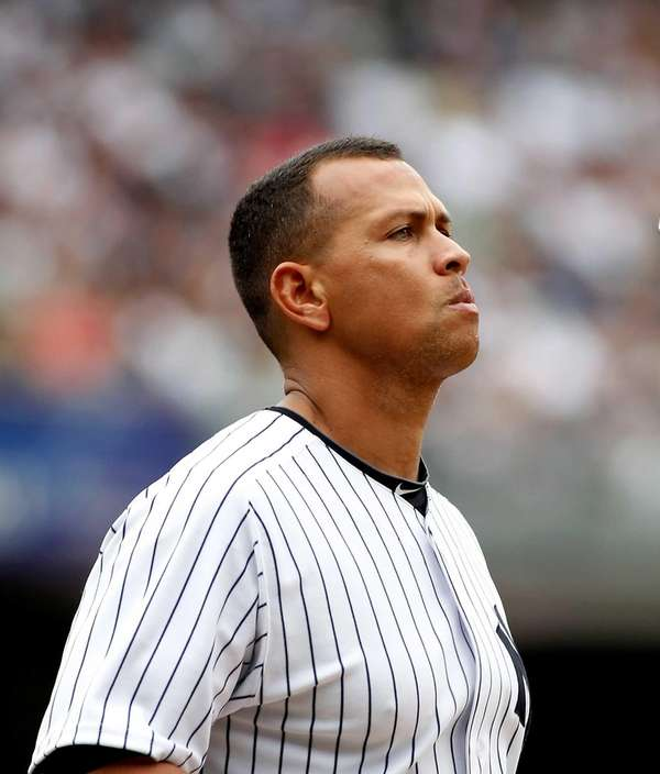 Alex Rodriguez flips his helmet after lining out