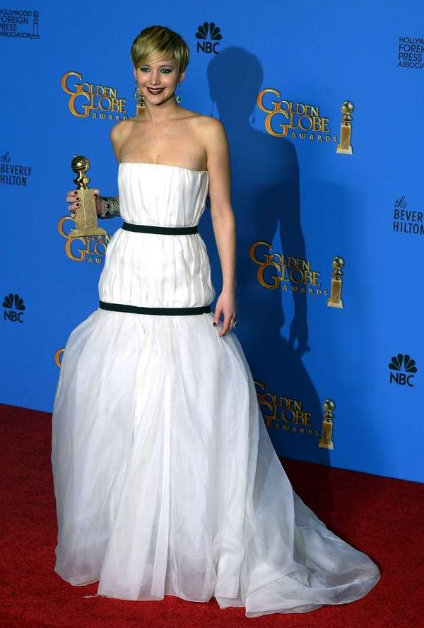 Jennifer Lawrence with her Golden Globe for Best