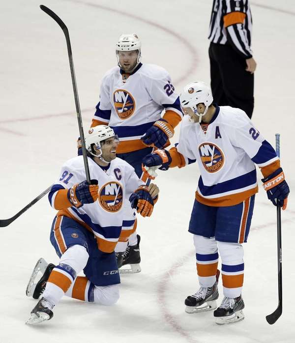 John Tavares (91) and Thomas Vanek (26) congratulate