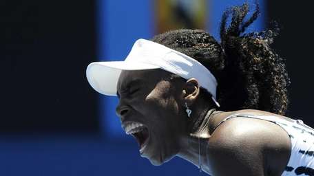 Venus Williams yells in frustration during her first