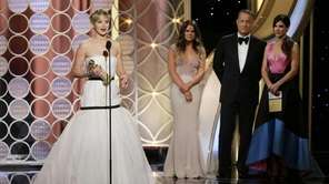 Jennifer Lawrence, left, accepting the award for best