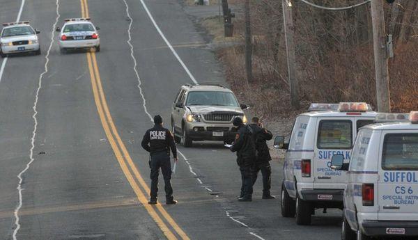 Suffolk County police investigators photograph the scene on