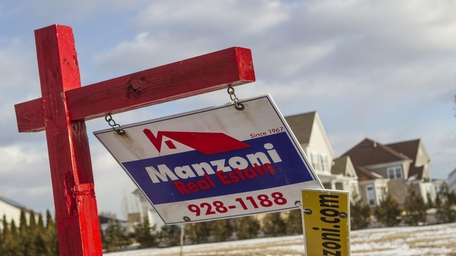 Long Island home prices were nearly flat last