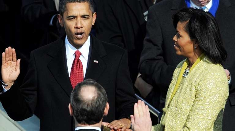 Barack Obama taking the oath of office by